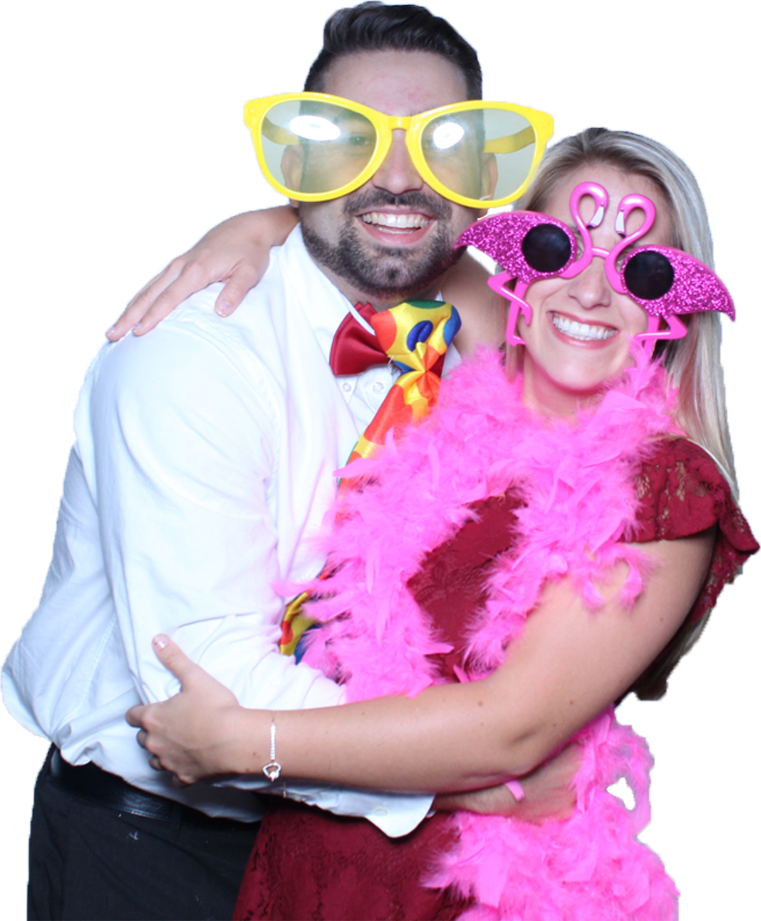 Happy couple using photo booth rental